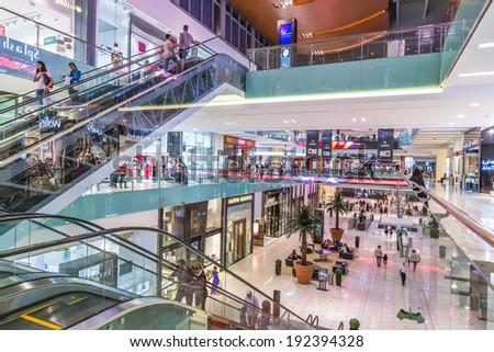DUBAI, UAE - NOVEMBER 14: Shoppers at Dubai Mall on November 14, 2012 in Dubai. At over 12 million sq ft, it is the world's largest shopping mall