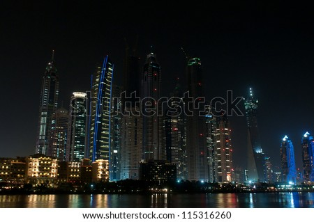 DUBAI, UAE - NOVEMBER 26: Skyscrapers in Dubai Marina at night, United Arab Emirates, Nov 26, 2011 Dubai is the most expensive city in the Middle East.