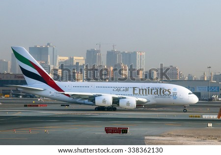 DUBAI, UAE - NOVEMBER 10, 2015: The Airbus A380 Emirates take off on Dubai International Airport. Plane for 615 passengers is biggest airliner on the world. - stock photo
