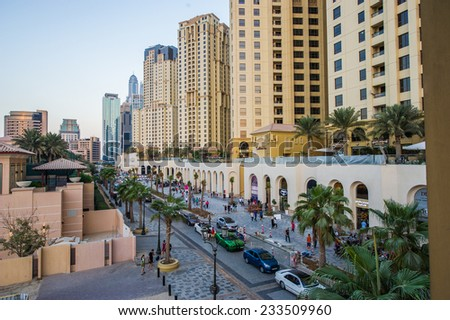 DUBAI, UAE - NOVEMBER 21: The Walk at Jumeirah Beach Residence on November 21, 2014 in Dubai, United Arab Emirates. In the city of artificial channel length of 3 kilometers along the Persian Gulf. - stock photo