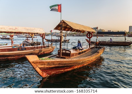 DUBAI, UAE-NOVEMBER 8: Traditional Abra ferries on November 8, 2013 in Dubai, UAE. Shipbuilding technology is unchanged from the 18th century. - stock photo