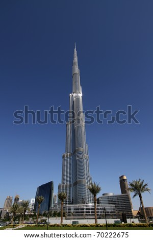 DUBAI, UAE - NOVEMBER 17: View at Burj Khalifa in Dubai, on November 17, 2010. This skyscraper is the tallest man-made structure ever built, at 828 m. - stock photo