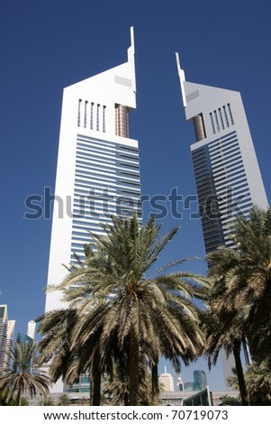 DUBAI, UAE - NOVEMBER 17: View at Emirates Towers in Dubai at Novemvber 17, 2010. This complex contains the Emirates Office Tower and Jumeirah Emirates Towers Hotel, which rise to 355 m and 309 m. - stock photo