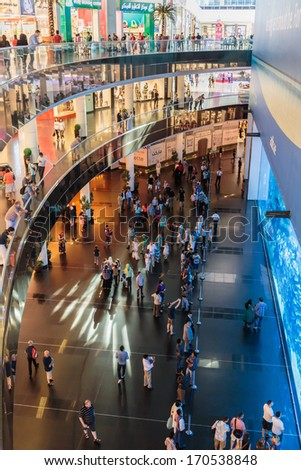 DUBAI, UAE - NOVEMBER 9: View of Dubai Aquarium inside Dubai Mall on November 9, 2013 in Dubai, UAE. The Aquarium has the longest plexi glass tunnel in the world. - stock photo
