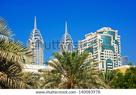 DUBAI, UAE-NOVEMBER 12: View of the Chrysler building in Dubai on November 12, 2012.  Dubai builds two imitations of NYC Chrysler building. - stock photo