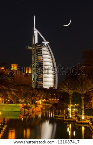 DUBAI, UAE - NOVEMBER 15: View of the hotel Burj Al Arab from Souk Madinat Jumeirah. Madinat Jumeirah encompasses two hotels and clusters of 29 traditional Arabic houses.  Nov 15, 2012