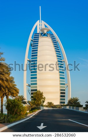 DUBAI, UAE - NOVEMBER 15: View of the hotel Burj Al Arab from Souk Madinat Jumeirah. Nov 15, 2012 in Dubai. Burj Al Arab is a luxury 7 stars hotel built  in front of Jumeirah beach. - stock photo