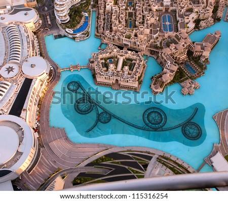 DUBAI, UAE - NOVEMBER 26: View on Dubai Fountain from the lookout Burj Khalifa. Dubai, United Arab Emirates. Nov 26, 2011. Dubai is the most expensive city in the Middle East. - stock photo