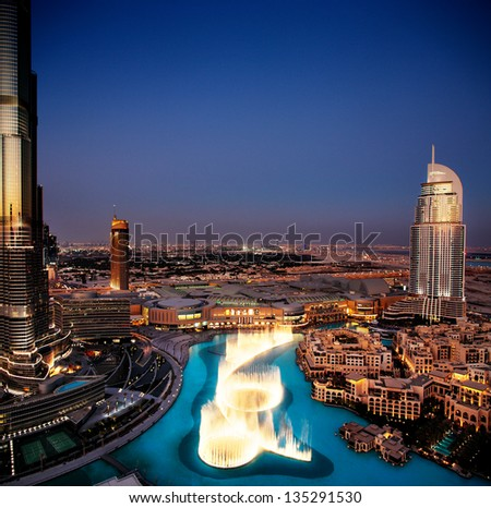 DUBAI, UAE - OCT 17: The Dancing Fountain of Dubai on Oct 17, 2010 in Dubai, UAE. The fountain is overlooked by the Burj Khalifa - the tallest building in the world and the Address Hotels - stock photo