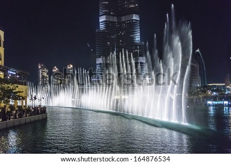 DUBAI, UAE - OCTOBER 1, 2012: A record-setting fountain system set on Burj Khalifa Lake - 6600 lights and 25 projectors, it shoots water 150 m into the air. United Arab Emirate.