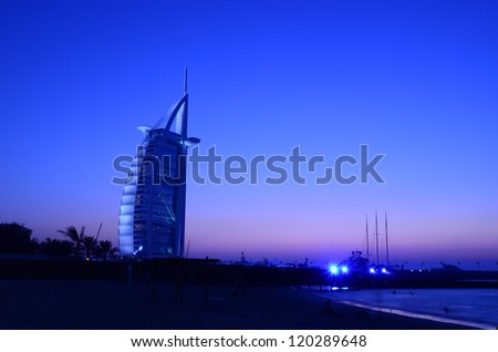 "DUBAI, UAE - OCTOBER 11: Burj Al Arab hotel on Oct 11, 2012 in Dubai. Burj Al Arab is a luxury 7 stars hotel built on a man made island in  front of Jumeirah beach. Also known as ""Arab Sail"". - stock photo"