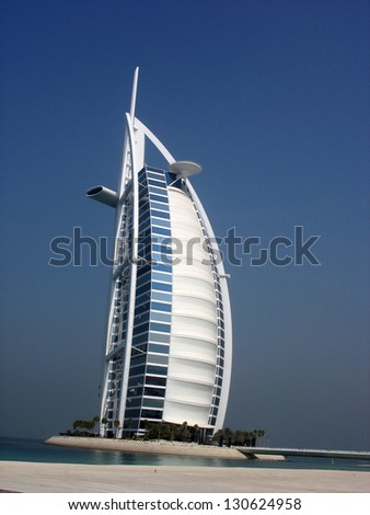DUBAI, UAE - OCTOBER 24: Burj Al Arab hotel on October 24, 2007 in Dubai. Burj Al Arab is a luxury 7 stars hotel  and one of the most luxurious in the world. It was built on an artificial island. - stock photo