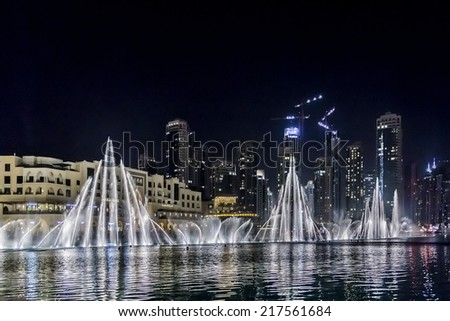 DUBAI, UAE - OCTOBER 1, 2012: Dubai Fountain is world largest choreographed fountain system set on Burj Khalifa Lake - 6600 lights and 25 colored projectors, it shoots water 152 m into the air.