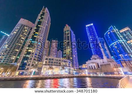 DUBAI, UAE - OCTOBER 9, 2015: Dubai Marina night skyline. The city attracts 13 million people wordwide every year. - stock photo