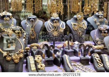 "DUBAI, UAE - OCTOBER 28: Gold on the famous ""Golden souk"" in Dubai Deira market on 28 October, 2014, Dubai, UAE - stock photo"
