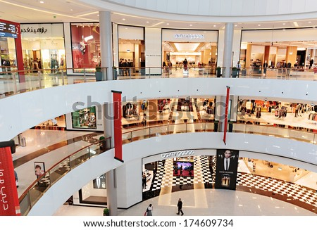 DUBAI, UAE - OCTOBER 31, 2013: Inside modern luxuty mall  in Dubai. At over 12 million sq ft, it is the world's largest shopping mall based on total area. - stock photo