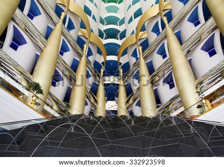 Dubai, UAE - October 10, 2012: Interior of Burj Al Arab lobby. Burji Al Arab is the most expensive 7 star luxury hotel in the world, Dubai, United Arab Emirates. - stock photo
