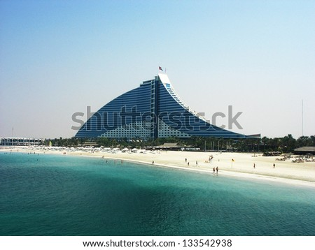 DUBAI, UAE - OCTOBER 23: Jumeirah Beach Hotel on October 23, 2007 in Dubai. This wave-shaped hotel complements the sail-shaped Burj Al Arab, which is adjacent to the Jumeirah Beach Hotel - stock photo