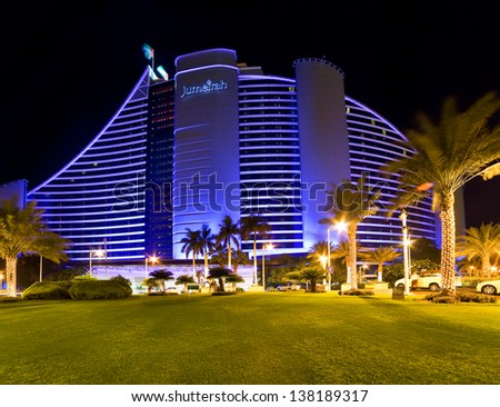 DUBAI, UAE - OCTOBER 23: Jumeirah Beach Hotel on october 23, 2012 in Dubai, UAE. Well-known for its wave-shaped silhouette, remains one of the best recognizable landmarks of Dubai, UAE