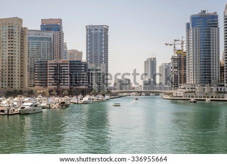 Dubai, UAE - October 02: Marina walk district in Dubai, UAE on October 02 2015. Dubai Marina is an artificial canal city, carved along 3 km stretch of Persian Gulf shoreline.  - stock photo