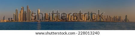 DUBAI, UAE - OCTOBER 16: Modern buildings in Dubai Marina, Dubai, UAE. In the city of artificial channel length of 3 kilometers along the Persian Gulf, taken on 16 October 2014 in Dubai. - stock photo