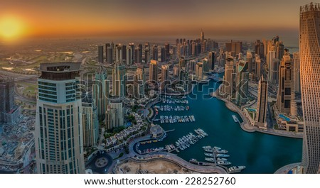 DUBAI, UAE - OCTOBER 12: Modern buildings in Dubai Marina, Dubai, UAE. In the city of artificial channel length of 3 kilometers along the Persian Gulf, taken on 12 October 2014 in Dubai. - stock photo