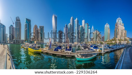 DUBAI, UAE - OCTOBER 13: Modern buildings in Dubai Marina, Dubai, UAE. In the city of artificial channel length of 3 kilometers along the Persian Gulf, taken on 13 October 2014 in Dubai.