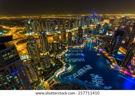DUBAI, UAE - OCTOBER 10: Modern buildings in Dubai Marina, Dubai, UAE. In the city of artificial channel length of 3 kilometers along the Persian Gulf, taken on 10 October 2014 in Dubai. - stock photo