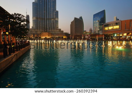 DUBAI, UAE - OCTOBER 31: Night view Dancing fountains downtown and in a man-made lake in Dubai, UAE on November 13, 2013. The Dubai Dancing fountains are world's largest fountains with height 150 m.