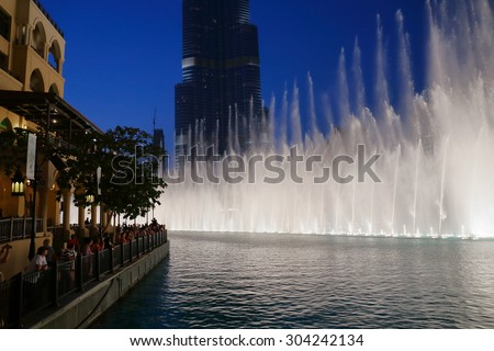 DUBAI, UAE - OCTOBER 31: Night view Dancing fountains downtown and in a man-made lake in Dubai, UAE on November 13, 2013. The Dubai Dancing fountains are world's largest fountains with height 150 m. - stock photo