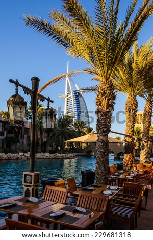 DUBAI, UAE - 10 OCTOBER 2014: View for Burj Al Arab hotel from the Madinat Jumeirah in Dubai, UAE. Burj Al Arab with 321 meters high is the most luxurious 7 star hotel and a symbol of modern Dubai. - stock photo