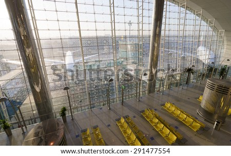 DUBAI, UAE - OCTOBER 17, 2013: view from Emirates business class lounge. Emirates is the largest airline in the Middle East, operating from its hub at Dubai International Airport - stock photo