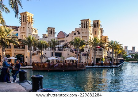 DUBAI, UAE -OCTOBER 10: Views of Madinat Jumeirah hotel, on October 10, 2014, Dubai, UAE. Madinat Jumeirah - luxury 5 star hotel with own artificial canals and boats. - stock photo