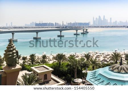 DUBAI, UAE - SEP 30: 5 stars Hotel Atlantis (1,539 spacious guest rooms including 166 suites) on man-made island of Palm Jumeirah at September 30, 2012 in Dubai, United Arab Emirates. Pool and sea. - stock photo
