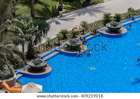 DUBAI, UAE - SEPTEMBER 7, 2015: A wonderful beach in 5 stars Hotel Atlantis (1,539 spacious guest rooms including 166 suites) on man-made island of Palm Jumeirah. United Arab Emirates.  - stock photo