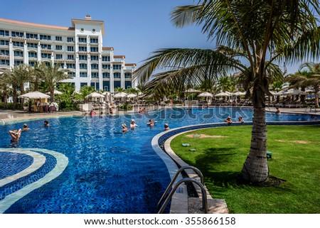 DUBAI, UAE - SEPTEMBER 10, 2015: A wonderful pool in 5 stars Hotel Waldorf Astoria Dubai Palm Jumeirah on man-made island of Palm Jumeirah. United Arab Emirates.  - stock photo