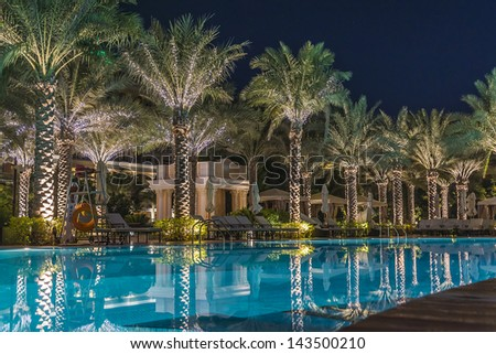 DUBAI, UAE - SEPTEMBER 29: Kempinski Hotel and Residences at night (129 luxury suites, penthouses and villas) on man-made island of Palm Jumeirah at September 29, 2012 in Dubai, United Arab Emirates. - stock photo