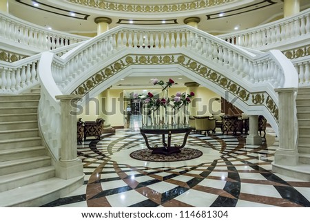 DUBAI, UAE - SEPTEMBER 29: Kempinski Hotel and Residences (129 luxury suites, penthouses and villas) on man-made island of Palm Jumeirah at September 29, 2012 in Dubai, United Arab Emirates. Interior. - stock photo