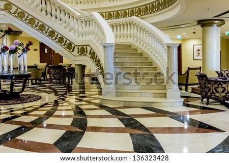 DUBAI, UAE - SEPTEMBER 29: Kempinski Hotel and Residences (129 luxury suites, penthouses and villas) on man-made island of Palm Jumeirah on September 29, 2012 in Dubai, United Arab Emirates. Interior. - stock photo