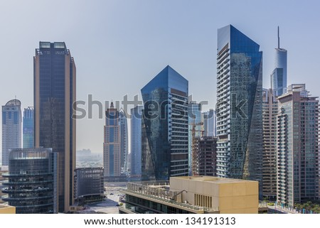 DUBAI, UAE - SEPTEMBER 29: Modern skyscrapers in morning in Dubai Marina on September 29, 2012, Dubai, UAE. Dubai Marina - artificial canal city, carved along a 3 km stretch of Persian Gulf shoreline.