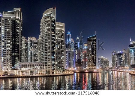 DUBAI, UAE - SEPTEMBER 29, 2012: Night view at modern skyscrapers in Dubai Marina. Marina - artificial canal city, carved along a 3 km stretch of Persian Gulf shoreline. Dubai, United Arab Emirates.