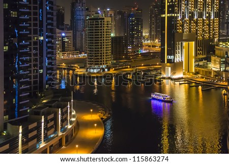 DUBAI, UAE - SEPTEMBER 29: Night view at modern skyscrapers in Dubai Marina on September 29, 2012 in Dubai, UAE. Dubai Marina - artificial canal city, carved along a stretch of Persian Gulf shoreline. - stock photo