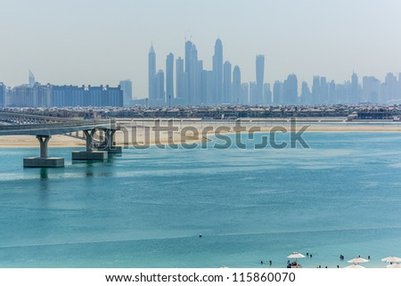DUBAI, UAE - SEPTEMBER 30: 5-star Hotel Atlantis (1,539 spacious guest rooms including 166 suites) on man-made island of Palm Jumeirah at September 30, 2012 in Dubai, United Arab Emirates. Beach.