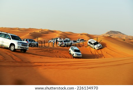 DUBAI, UAE - SEPTEMBER 12: The Dubai desert trip in off-road car is major tourists attraction in Dubai on September 12, 2013 in Dubai, UAE - stock photo
