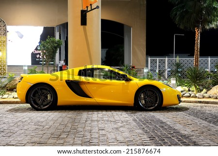 DUBAI, UAE - SEPTEMBER 12: The luxury sport car is on the Walk at JBR on September 12, 2013 in Dubai, UAE. In the city of artificial channel length of 3 kilometers along the Persian Gulf. - stock photo