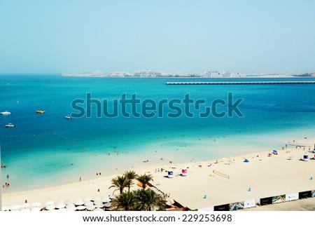 DUBAI, UAE - SEPTEMBER 11: The tourists enjoying their vacation at luxury hotel on September 11, 2013 Dubai, UAE. Up to 10 million tourists have visited UAE  in year 2013. - stock photo