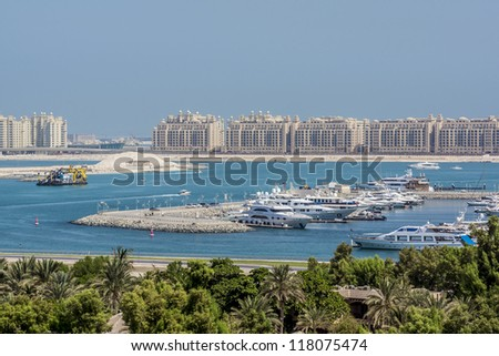 DUBAI, UAE - SEPTEMBER 29: View at Dubai Marina and man-made island of Palm Jumeirah on September 29, 2012 in Dubai, UAE. Dubai Marina - artificial canal city, carved along Persian Gulf shoreline. - stock photo