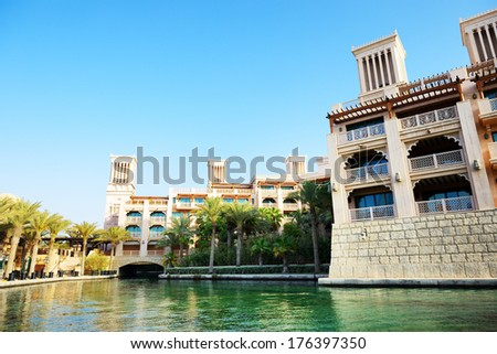 DUBAI, UAE - SEPTEMBER 9: View of the Souk Madinat Jumeirah. Madinat Jumeirah encompasses two hotels and clusters of 29 traditional Arabic houses on September 9, 2013 in Dubai, UAE - stock photo