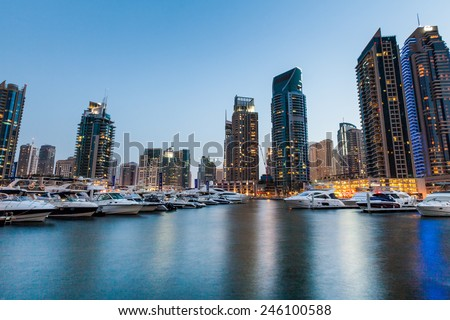 DUBAI, UNITED ARAB EMIRATES - APRIL 30: An Aerial view of Dubai Marina Towers in Dubai, United Arab Emirates on April 30, 2012. Dubai Marina is a district in Dubai and an artificial canal city. - stock photo