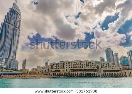 Dubai, United Arab Emirates - Dec 2, 2014: Commercial Center Souk Al Bahar and he Address hotel, near the highest building in the world, burj Khalifa with a pond were worlds largest fountain show is. - stock photo